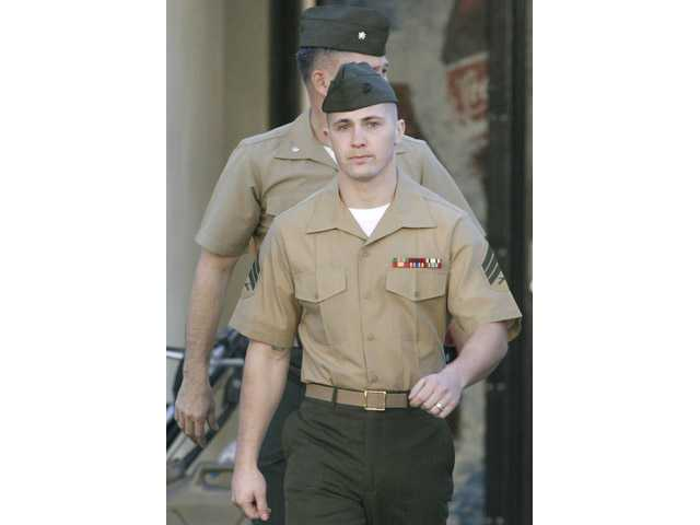 In this Dec. 7, 2006, file photo, Marine Corps Sgt. Lawrence Hutchins III of Plymouth, Mass., arrives for his arraignment at Camp Pendleton Marine Corps Base, Calif.