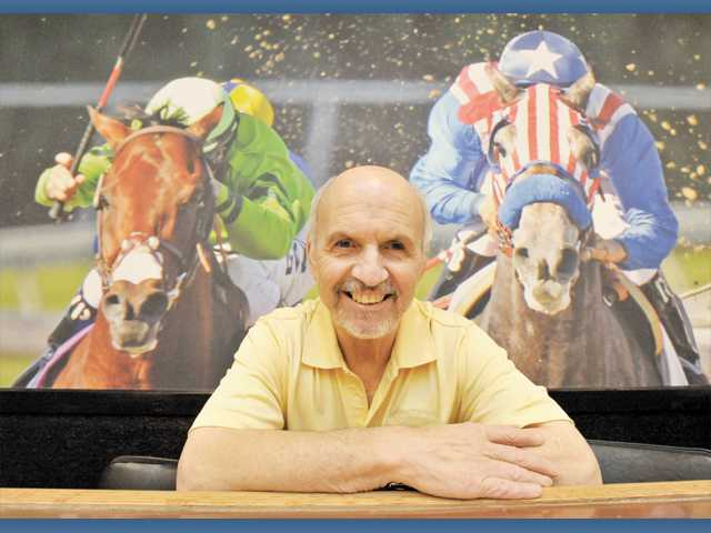 "Santa Clarita Lanes owner Tom Cristi sits at the bar, where there will soon be a   ""Watch and Wager"" off-track betting lounge at Saugus bowling alley."