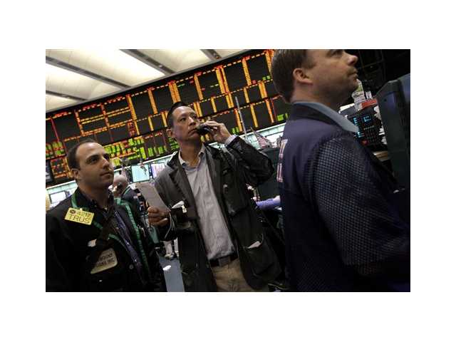 Traders work the crude oil options pit at the New York Mercantile Exchange Tuesday.