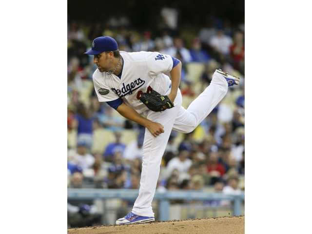 Los Angeles Dodgers starting pitcher Aaron Harang throws to the Cincinnati Reds on Wednesday in Los Angeles.