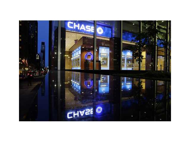Automobiles pass a JP Morgan Chase building in New York.