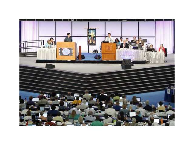 Rev. Neal Presa, at podium on right, serves as moderator during a session of the 220th General Assembly (2012) of the Presbyterian Church (USA) on Thursday