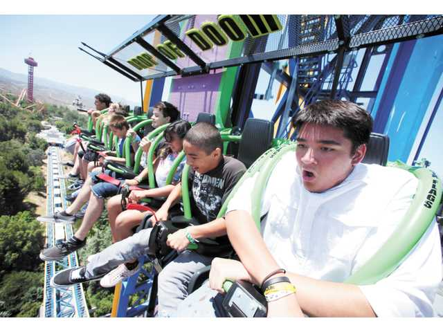 Billy Hanshaw, 17, of Canyon Country, right, reacts as a group from the Boys & Girls Club of Santa Clarita Valley descends at 85 miles per hour in Lex Luthor: Drop of Doom at Six Flags Magic Mountain in Valencia on Friday.