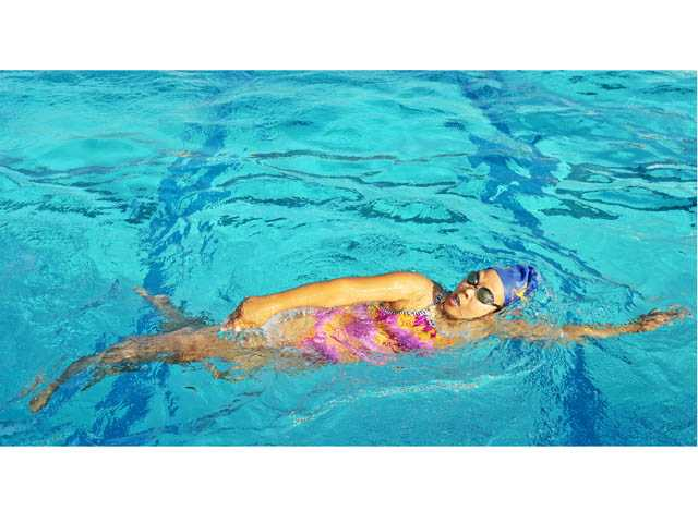 Flora Wong swims during a workout with the Santa Clarita Masters Club at the Santa Clarita Aquatic Center.