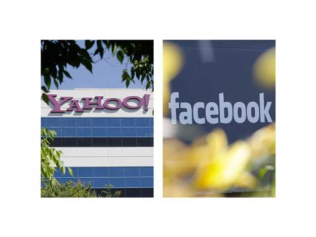 Photos shows the logos of Yahoo, left, and Facebook, outside their offices in Santa Clara, Calif. and Menlo Park, Calif.