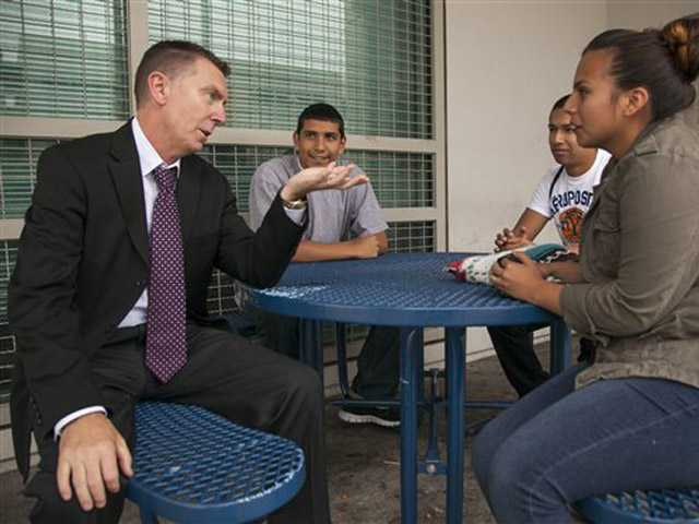 In this photo taken Thursday, June 14, 2012, Los Angeles Unified School District LAUSD Superintendent John Deasy tours the district in Los Angeles.