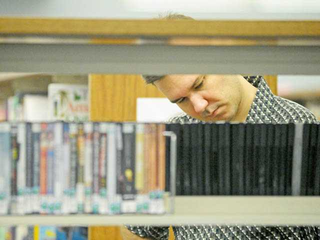 David Daugherty browses DVDs at the Canyon Country Jo Anne Darcy Library on Thursday.