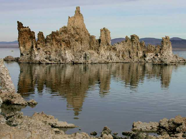 This Nov. 15, 2004, file photo, shows tufa towers in Mono Lake near Lee Vining, Calif. The ancient towers, composed of calcium carbonate, were formed underwater when fresh water springs mixed with minerals in the lake water, and became visible when lake water receded over the past 60 years due to water diversion to Los Angeles.