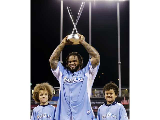 American League's Prince Fielder, of the Detroit Tigers, poses with his children Jadyn, left, and Haven after winning the Home Run Derby on Monday in Kansas City, Mo.