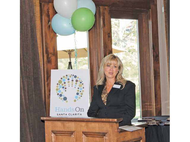Kathy Crone, executive director of the SCV Senior Center Foundation, recounted a Make a Difference Day project in 2011 that attracted volunteers to help renovate the Senior Center's administrative offices and established drought-tolerant landscaping at the center in Newhall.