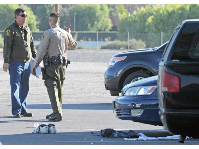Sheriff's officials talk at the scene of a shooting in the parking lot of the post office shopping center on the 18300 block of Soledad Canyon Road in Canyon Country on Oct. 31.