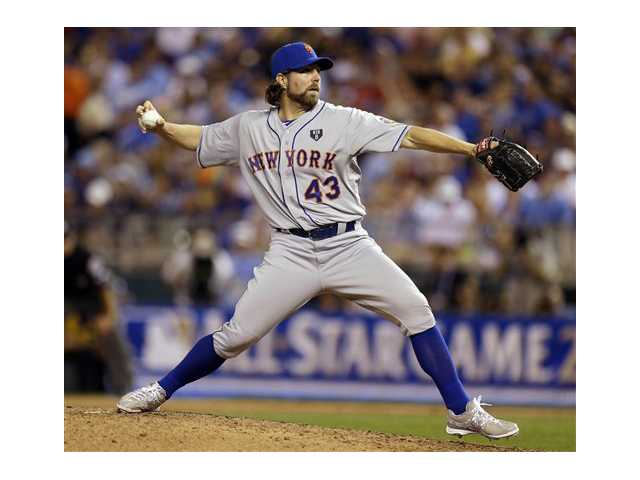 National League's R.A. Dickey, of the New York Mets, delivers against the American League during the sixth inning of the MLB All-Star baseball game, Tuesday.