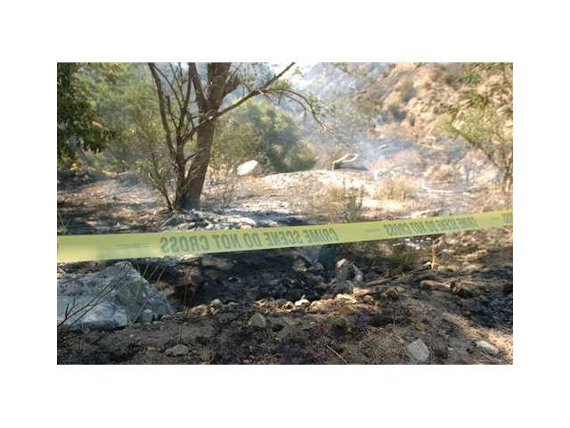 An area where the Waterman fire started and that burned more then 75 acres at Waterman Canyon, is sectioned off Monday July 9, 2012 in San Bernardino County.