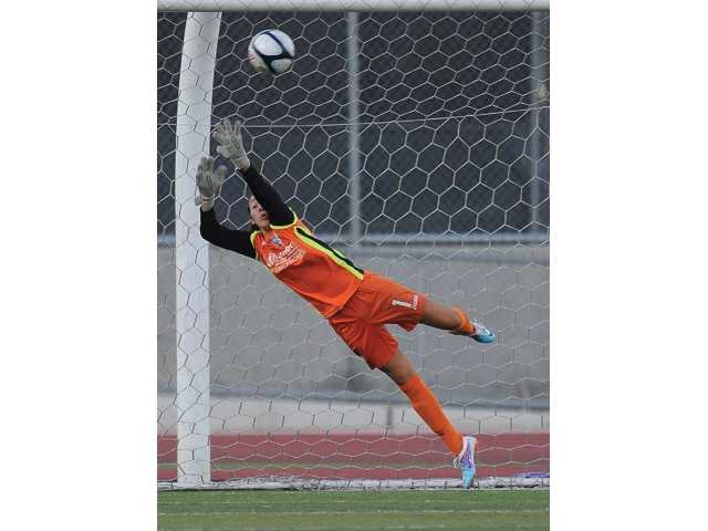 Santa Clarita Blue Heat goal keeper Cynthia Jacobo makes a save during Wednesday's game at Valencia High School.