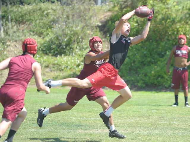 Hart High wide receiver Andrew MacArthur, right, goes up to catch a pass against Santa Paula on Wednesday during the COC Passing Tournament.