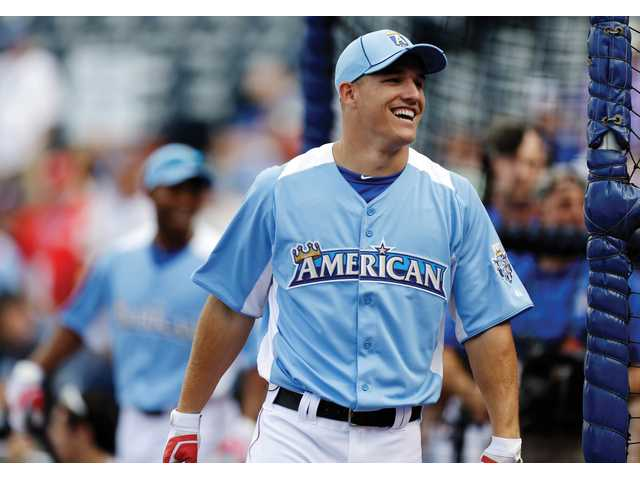 American League's Mike Trout, of the Los Angeles Angels, laughs during warmups for the MLB All-Star baseball game on Tuesday in Kansas City, Mo.