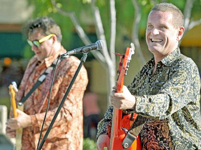 Igor Yuzov, left, and Oleg Bernov of the Red Elvises perform rock  'n' roll and traditional Russian music.