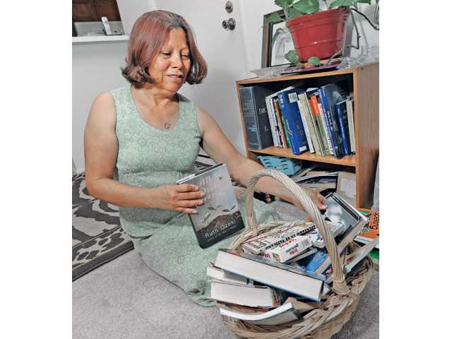 Morales gathers books to give away. She has published her own writing through iUniverse.