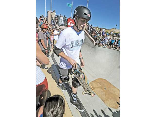 Legendary professional skateboarder Tony Hawk demonstrates his skills for the crowd at the Santa Clarita Skate Park in Santa Clarita on Saturday.