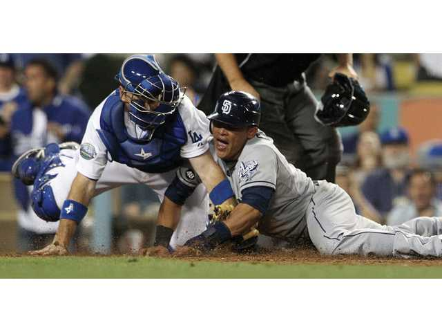 San Diego Padres' Everth Cabrera steals home to tie the score in Los Angeles on Saturday.