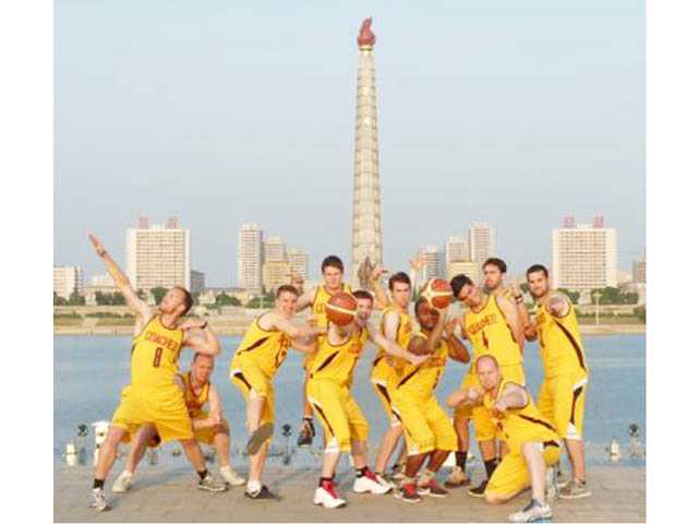 An American basketball team, featuring Valencia High coach Greg Hayes and former Valencia players Stevie Sansone and James Glass pose at various locations in North Korea,