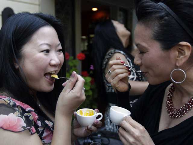 In this May 11 file photo, Minty O'Callaghan, left, and Kathy Kuwaye enjoy a carrot soup topped with a foie gras cream at the Sent Sovi restaurant in Saratoga