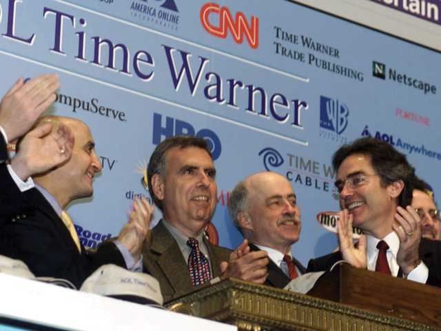 New York Stock Exchange Chairman Richard Grasso, left, and AOL Time Warner co-CEO Bob Pittman, right, join in the applause as AOL Time Warner CEO Gerald Levin, second left, rings the exchange opening bell Jan. 12, 2001. Ten years ago today, Pittman would step down from the company amid a shakeup.