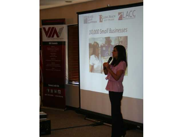 Leticia Valadez describes the Goldman Sachs 10,000 Small Businesses program benefits to VIA members at Tuesday's luncheon.