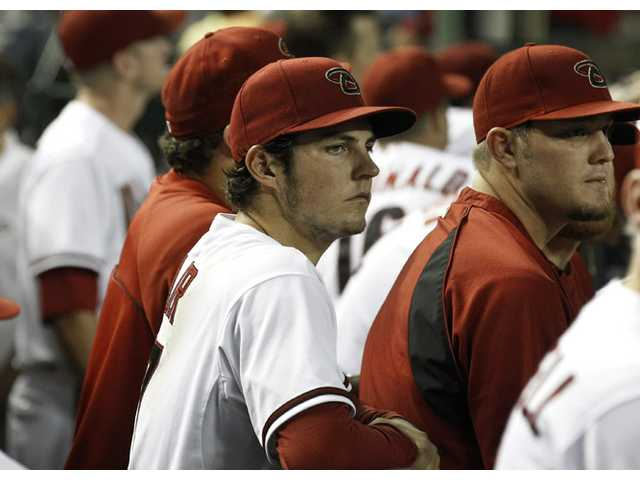 Arizona Diamondbacks pitcher and Hart High graduate Trevor Bauer, left, watches the action against the San Diego Padres with teammate Wade Miley after Bauer was pulled from the game during the fourth inning on July 3 in Phoenix.