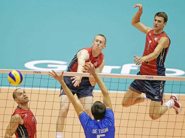 U.S. Men's National Volleyball player and Saugus High graduate David Smith, center, competes during a World League match on June 15.