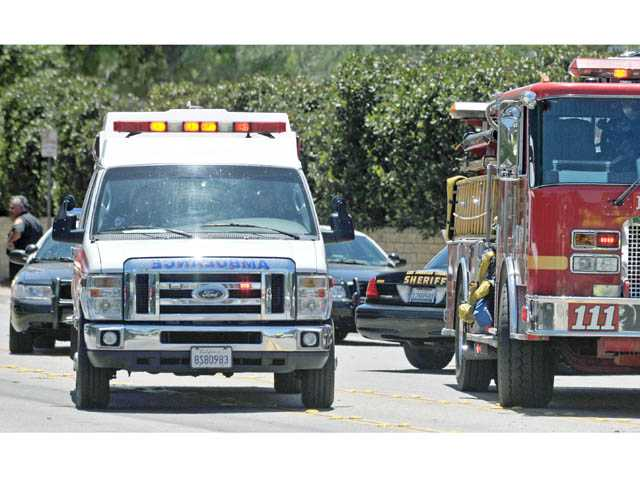 An ambulance transports a patient from the scene of a traffic collision on southbound Seco Canyon Road at Chaparro Drive in Saugus on Thursday.