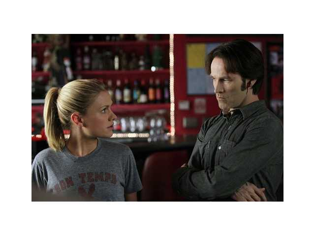 "Anna Paquin, left, and Stephen Moyer are shown in a scene from ""True Blood."""