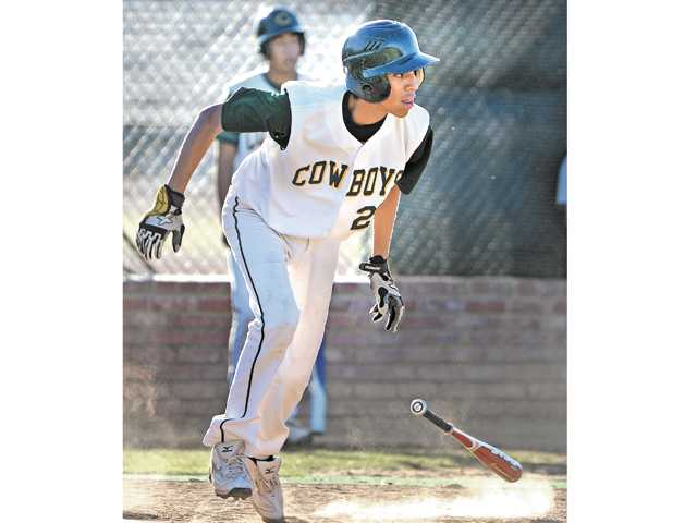 Canyon's Anthony Silva gets a hit in the sixth inning against Kennedy at Canyon High in their VIBL finale.