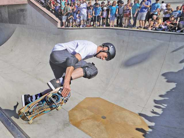 Legendary skateboarder Tony Hawk demonstrates his skills at the Santa Clarita Skatepark on Saturday.