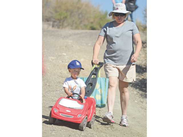 Linda Jenkins and her grandson Jack, 2, of Valencia, walk at the Elsmere Canyon Celebration at Whitney Canyon Park in Santa Clarita on Saturday.