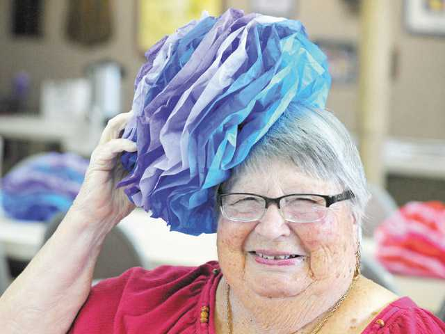 Helen Snipper poses with a pompom as she celebrates her 93rd birthday and 70th wedding anniversary at the Old West Masonic Lodge in Friendly Valley on July 12.