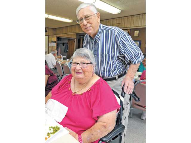 Lawrence and Helen Snipper pose for a photo while celebrating their 70th wedding anniversary with friends at the Old West Masonic Lodge in Friendly Valley on July 12.