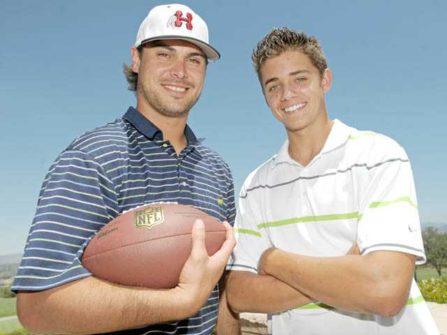 Miami Dolphins quarterback and former Hart High player Matt Moore, left, stands with with current Hart High quarterback Brady White.