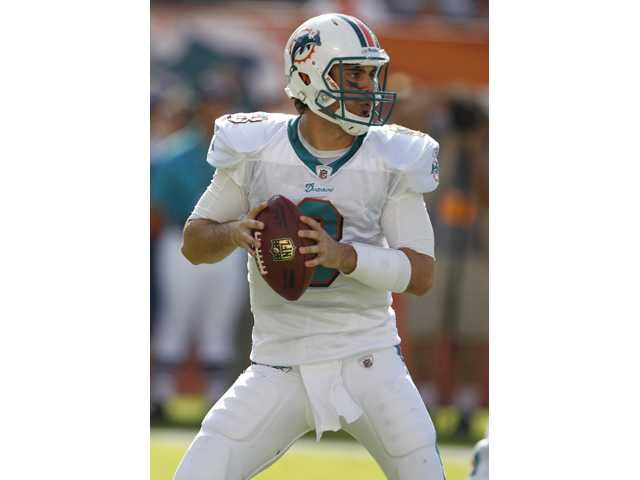 Miami Dolphins quarterback and Hart High graduate Matt Moore (8) looks to throw against the New York Jets in a Jan. 1 game in Miami.