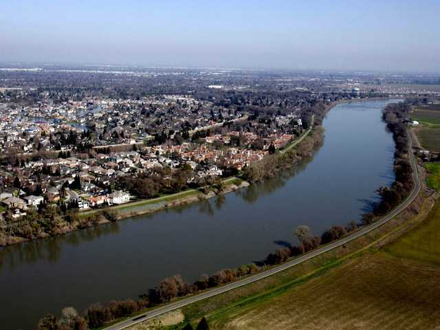 In this Feb. 22, 2006, photo, houses located in the Pocket Area of Sacramento, Calif., are seen along the Sacramento River. Gov. Jerry Brown and U.S. Department of the Interior Secretary Ken Salazar are set to make an announcement about Calif's plan for a new massive water infrastructure on Wednesday.
