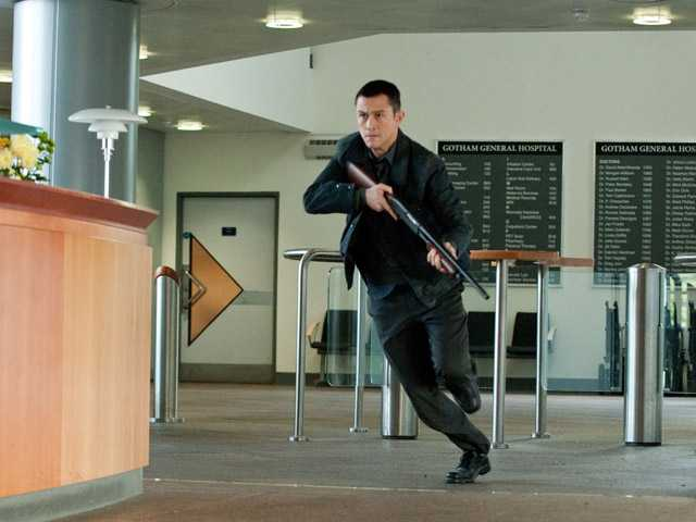 "In this publicity photo provided by Warner Bros. Pictures, Joseph Gordon-Levitt as John Blake is shown in a scene in Warner Bros. Pictures' and Legendary Pictures' action thriller ""The Dark Knight Rises."""