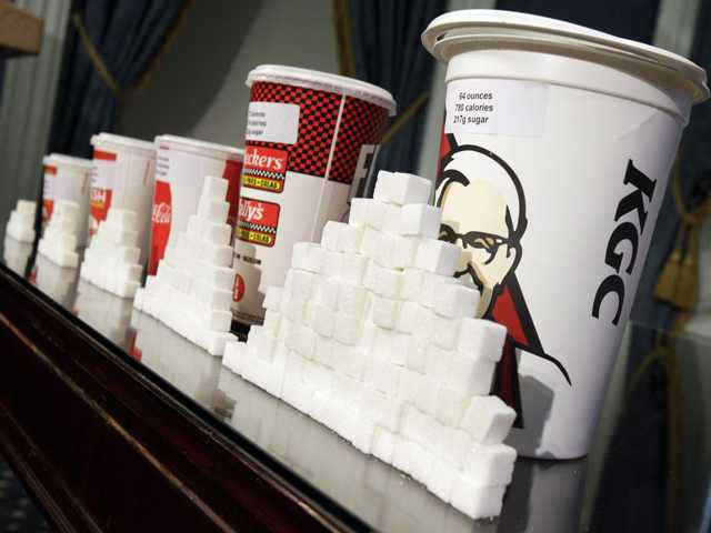 A display of various size cups and sugar cubes is shown at a news conference at New York's City Hall on May 31.