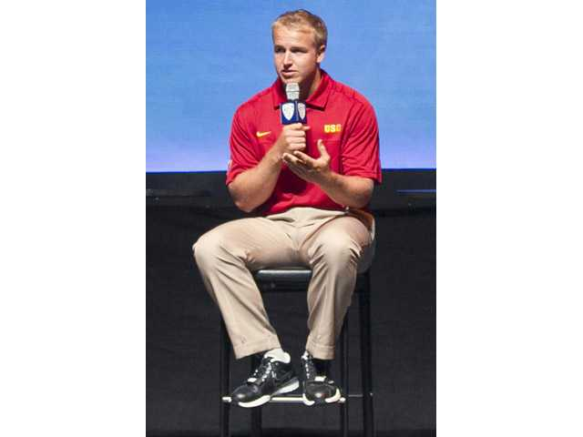 USC quarterback Matt Barkley responds to a question during the Pac-12 football media day on Tuesday in Universal City.