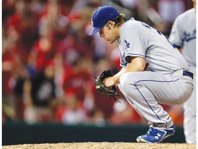 Los Angeles Dodgers starting pitcher Clayton Kershaw crouches during a game against the St. Louis Cardinals in the sixth inning of game on Tuesday in St. Louis.