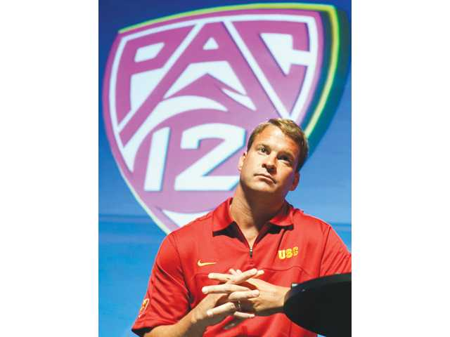 USC head coach Lane Kiffin takes questions at the Pac-12 football media day on Tuesday in Universal City.