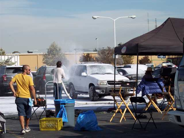 Snow makers, from Snow Business, create snow on a sunny day for a commercial shoot in Santa Clarita in November 2011.