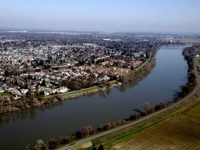 In this Feb. 22, 2006 file photo, houses located in the Pocket Area of Sacramento, Calif., are seen along the Sacramento River.