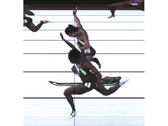 This photo provided by USA Track & Field shows the third-place finish of the women's 100-meter final from a photo-finish camera, shot at 3,000-frames-per-second, during the U.S. Olympic Track and Field Trials in Eugene, Ore. on JUne 23. Allyson Felix and Jeneba Tarmoh, in foreground, finished in a dead heat for the last U.S. spot in the 100 to the London Games, each leaning across the finish line in 11.068 seconds.