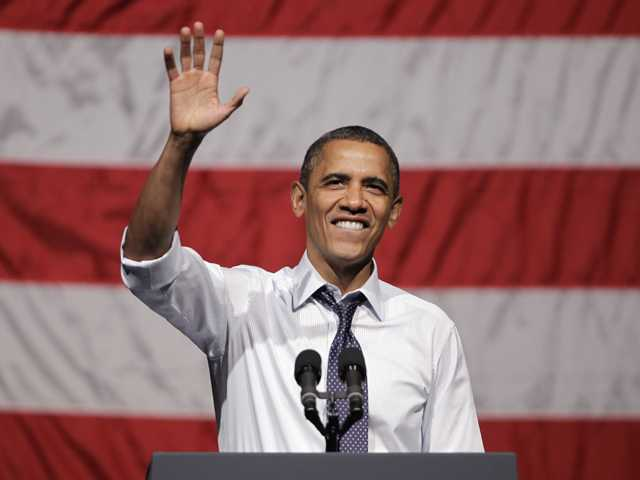 President Barack Obama waves at a campaign stop in Oakland on Monday.