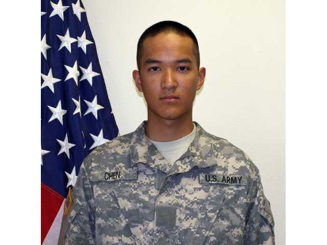 This undated file photo provided by the U.S. Army shows Pvt. Danny Chen,19, who was killed Monday, Oct. 3, 2011 in Kandahar, Afghanistan. The first of eight court-martial trials was set to begin Tuesday for U.S. soldiers accused of hazing Chen, a Chinese-American recruit, over his ethnicity until he killed himself in Afghanistan. Sgt. Adam Holcomb of Youngstown, Ohio, will be the first of eight men to go before a military court in Fort Bragg, N.C. Young faces a slew of charges, the most serious of which is negligent homicide, and could get nearly 18 years in prison if convicted on all counts.